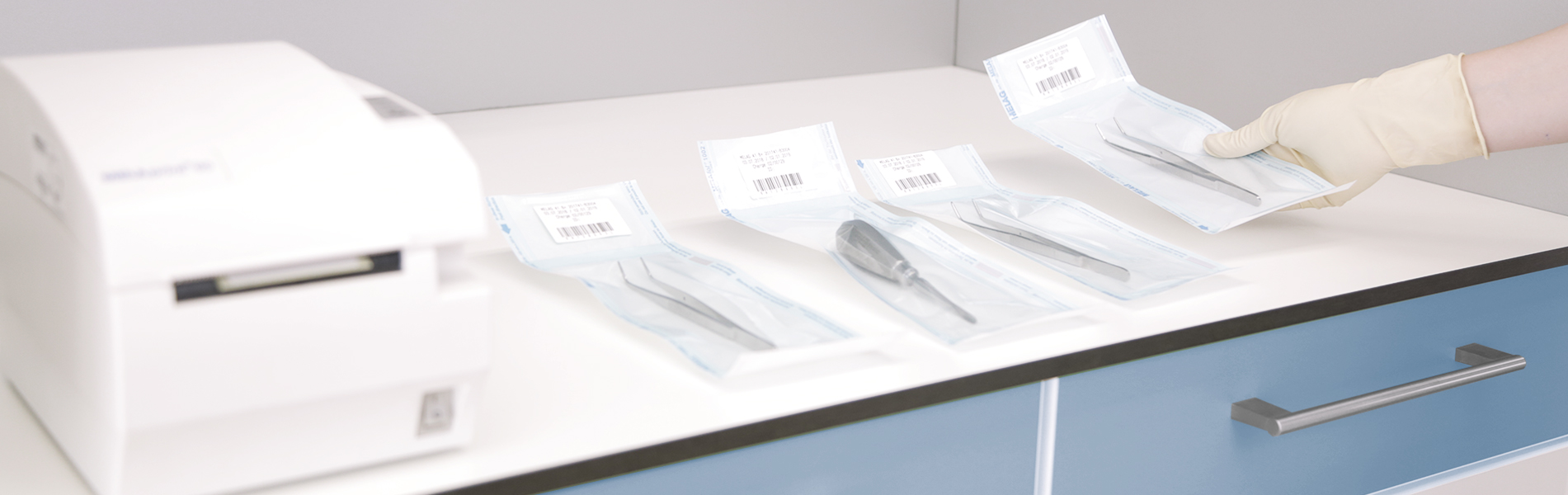 Sealed pouches with sterile instruments on work surface in the sterilization room