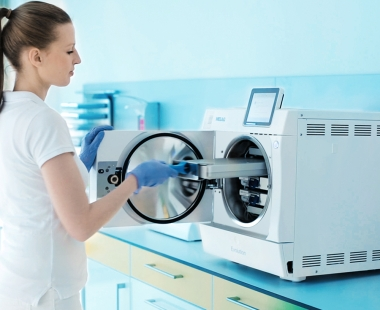 Dental assistant operates the Premium Class autoclave