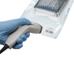 Scan device scanning label on sterilization package