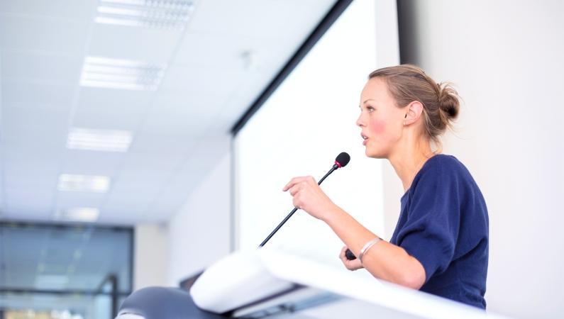 Woman giving speech at MELAG Academy